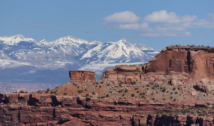 Red rocks snowcapped mountains Canyonlands National Park Utah