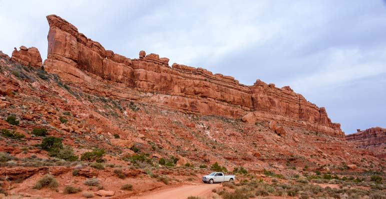 Truck at Valley of the Gods rock formations utah