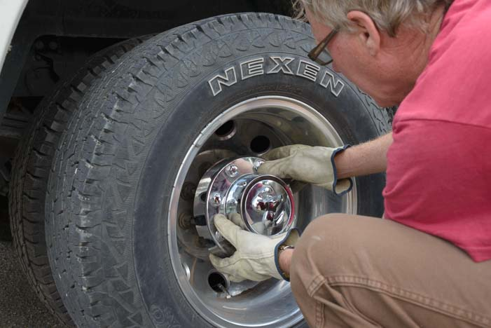 Remove hub cap on Ram 3500 truck rear wheel