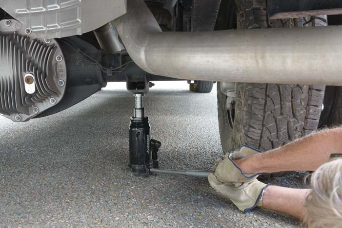 Raise the jack under Ram 3500 dually truck rear axle-2