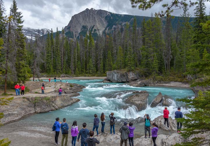 Tourists Natural Bridge Yoho National Park BC Canadian Rockies