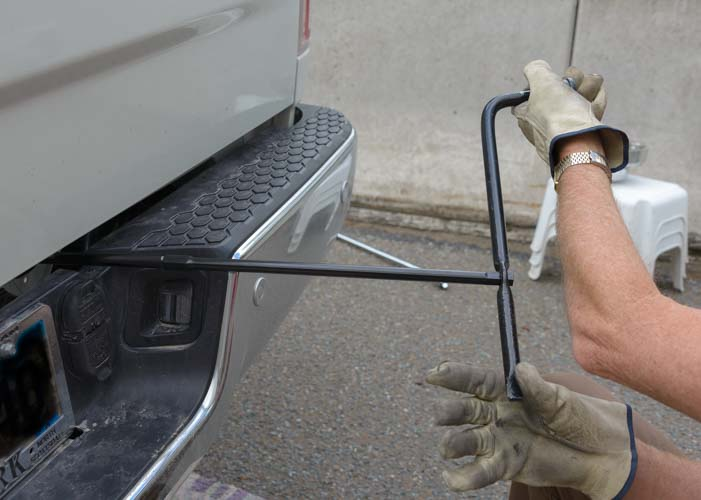 Lowering the spare tire on a Ram 3500 dually truck
