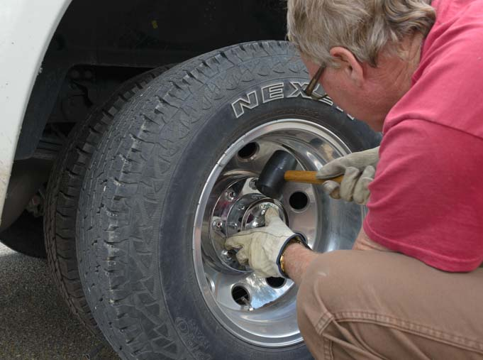 Replace hub cap on dually truck rear wheel