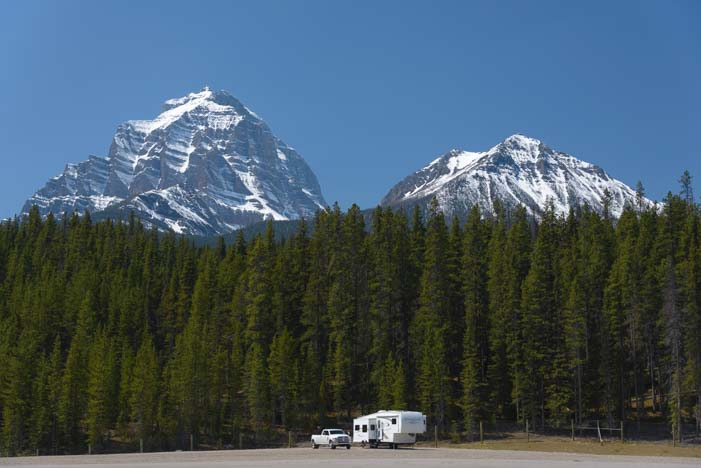 RV in mountains and trees