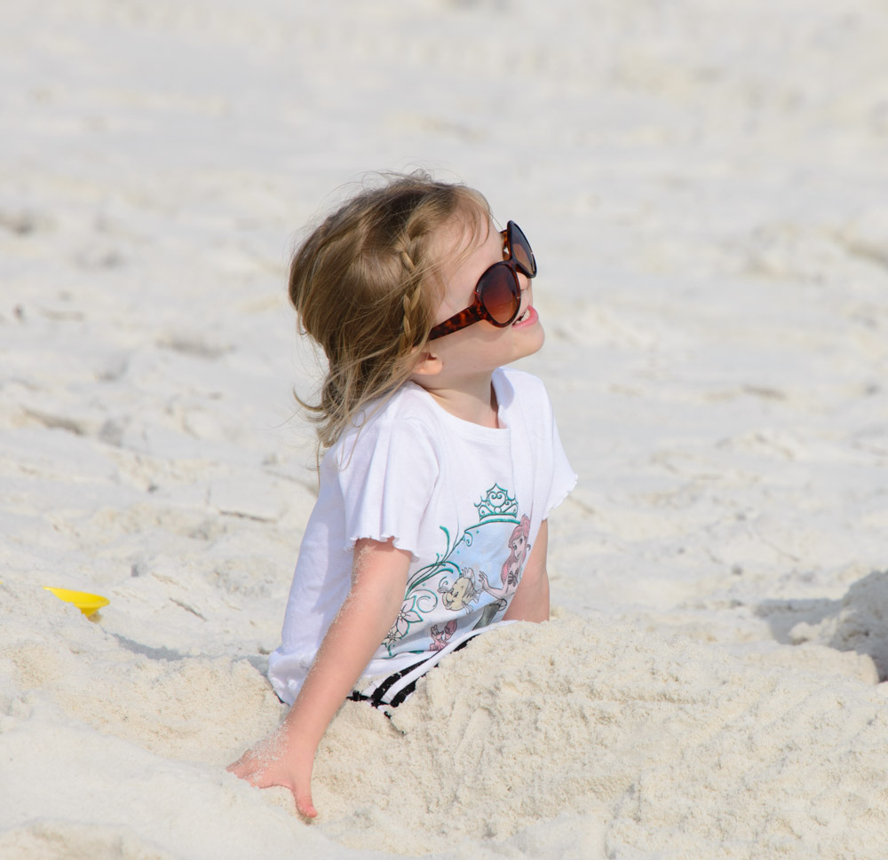 Playing in the white sand of Florida Northern Gulf Coast