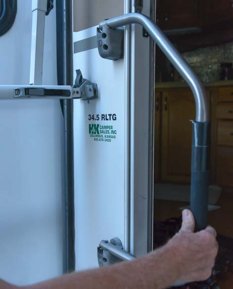 How to set up RV awning - Close RV door handle