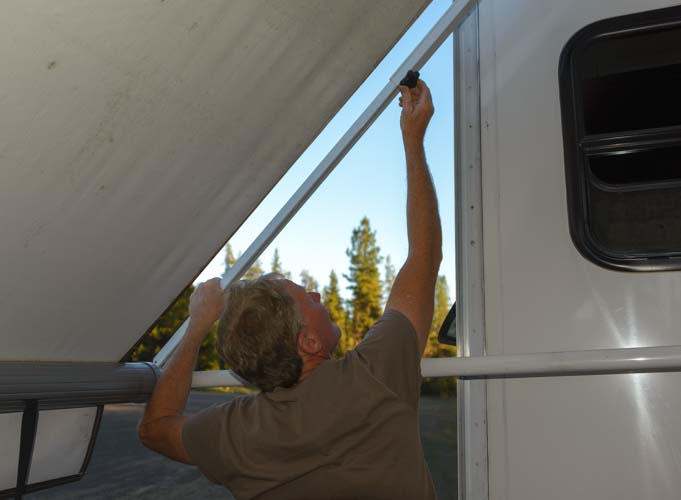 How to set up RV awning - Tighten down awning arm