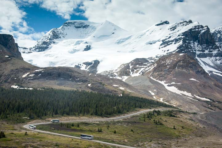 Tour buses on the Columbia Icefields Jasper National Park Alberta Canada