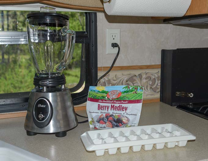 Osterizer blender and frozen berries for smoothie to keep cool in RV in summer