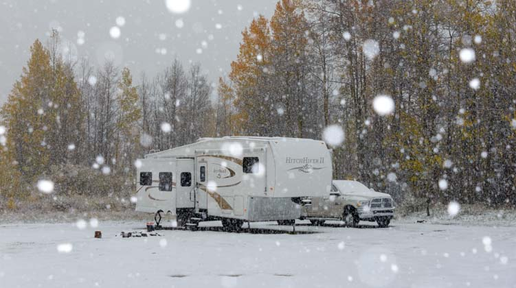 RV camping and travel in snow in winter