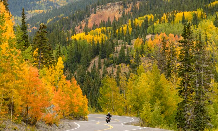 Motorcycle in fall colors San Juan Skyway Colorado Rocky Mountains