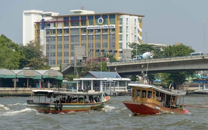 Boats on Chao Phraya River Bangkok Thailand