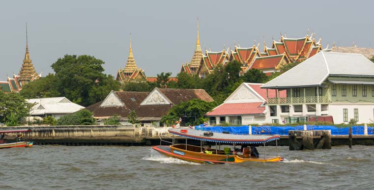 Boat and Grand Palace Chao Phraya River Bangkok Thailand