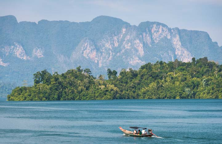 Khao Sok National Park Thailand Cheow Lan Lake Chiewlarn Lake longtail boat