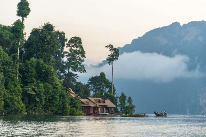 Morning mist Cheow Lan Lake Khao Sok National Park Thailand
