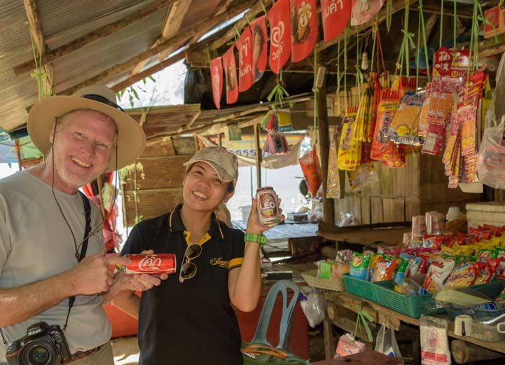 Buying a coke at an outdoor shop in Thailand