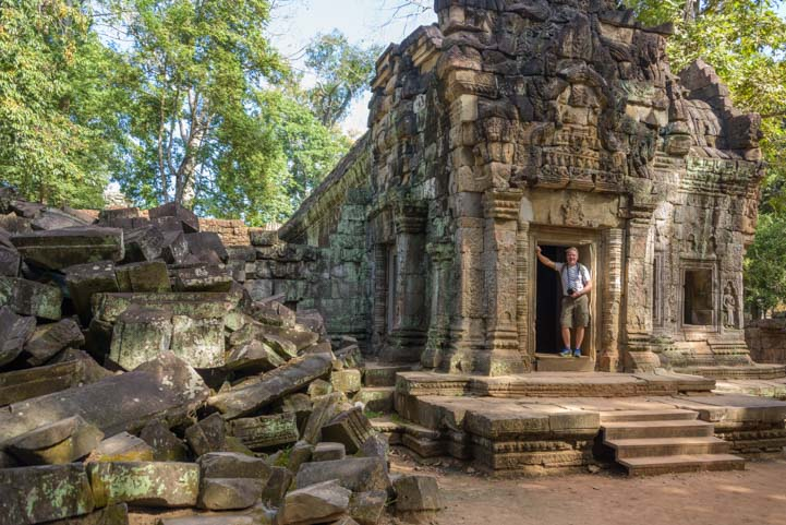 Doorway and fallen blocks Ta Prohm temple Angkor Siem Reap Cambodia