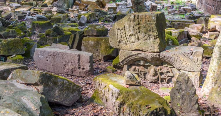 Carvings on blocks at Ta Prohm temple Siem Reap Angkor Cambodia