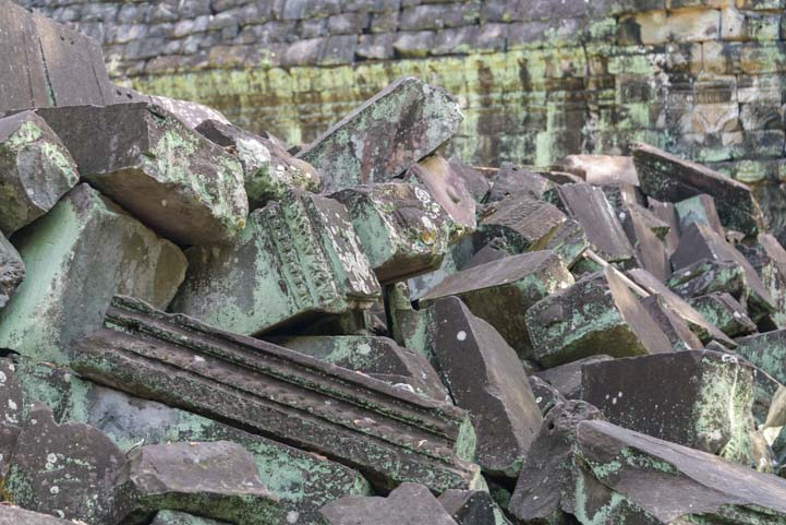 Ruins and fallen blocks at Ta Prohm temple Siem Reap Angkor Cambodia