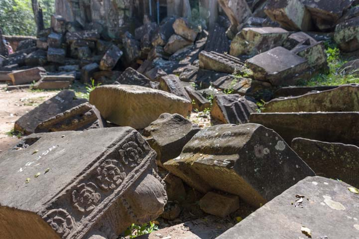 Carved stone rubble Ta Prohm ruins Siem Reap Angkor Cambodia 2