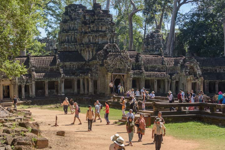 Tourists at entrance to Ta Prohm Angkor Siem Reap Cambodia