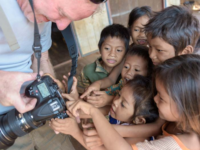 Sharing photos with Cambodian kids
