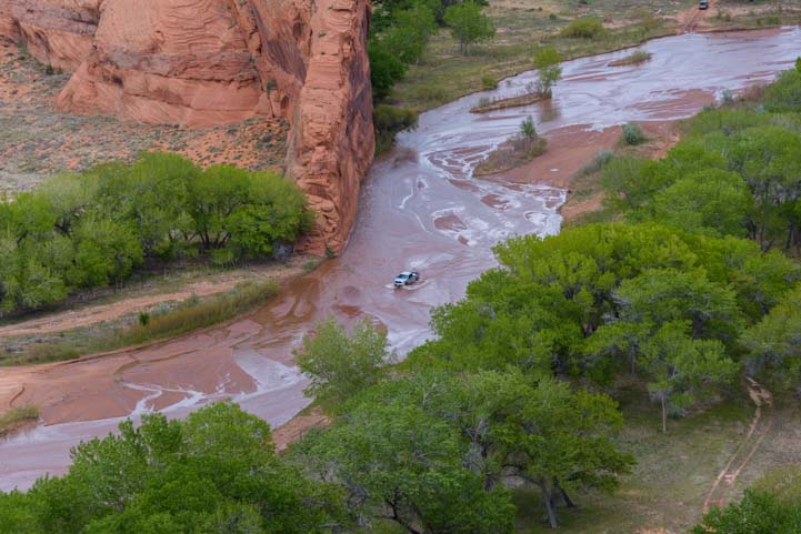 Car driving in wash at Tsegi Overlook Canyon de Chelly National Monument Arizona