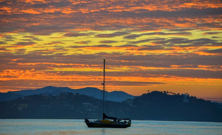 Sailboat at sunrise Santiago Bay Manzanillo Mexico