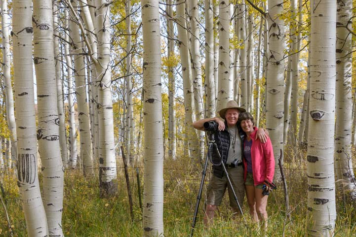 Happy photographers in aspen trees Colorado