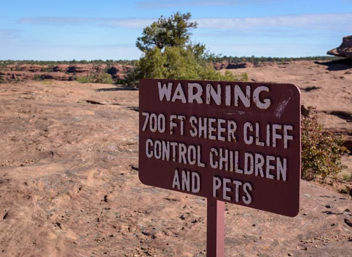 Sheer cliff warning sign Canyon de Chelly National Monument Arizona