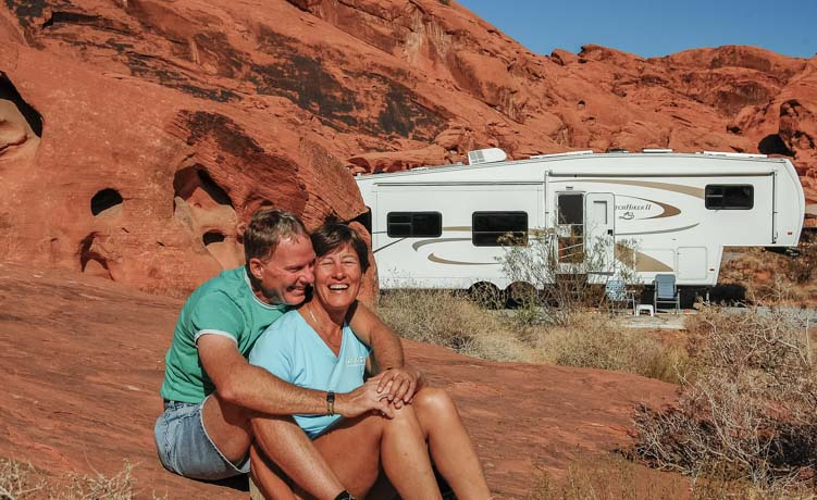 Happy RV travelers with fifth wheel trailer Valley of Fire State Park Nevada
