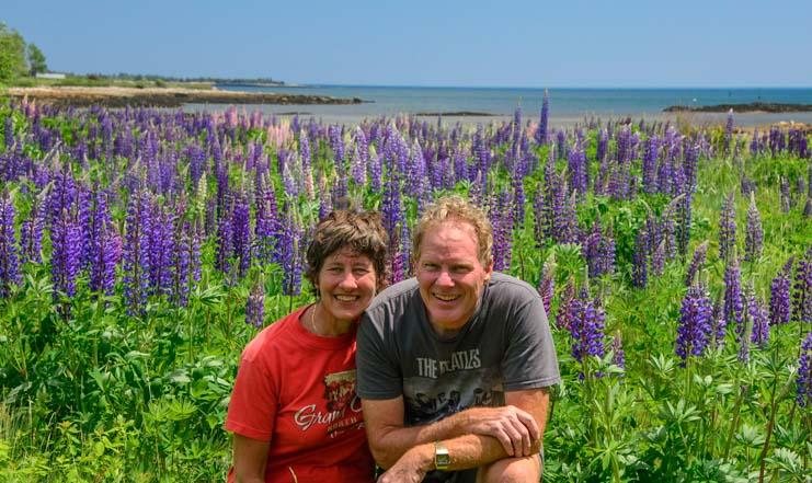 Happy campers in the wild lupine flowers in Maine