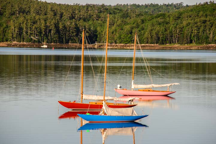 Colorful sailboats at anchor on Mt Desert Island Maine_