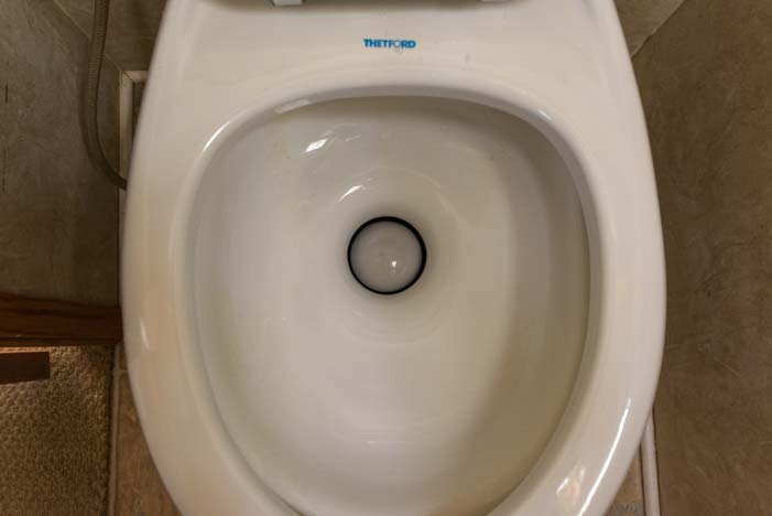 Broken RV toilet can't hold water in the toilet bowl