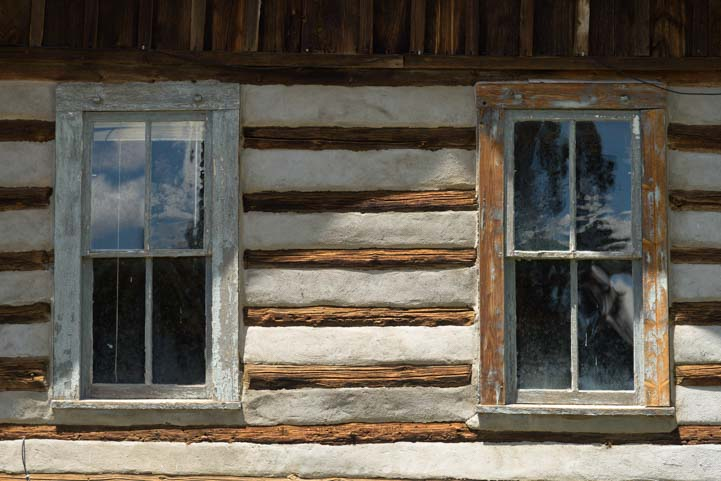 Old log cabin windows Valles Caldera National Preserve New Mexico