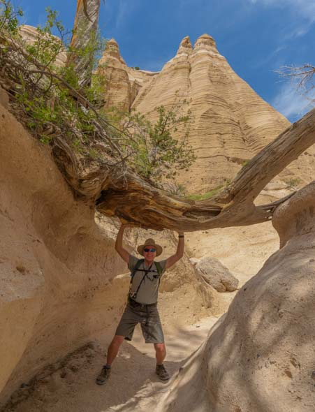 Holding up a log at Tent Rocks National Monument New Mexico