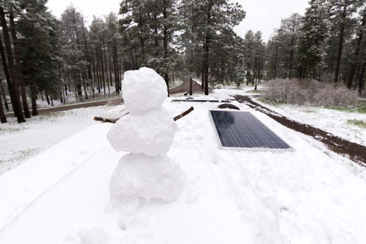 Snowman on RV roof with solar panels