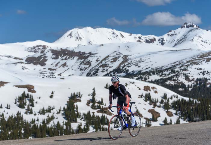 Cyclist on the top of Loveland Pass Colorado