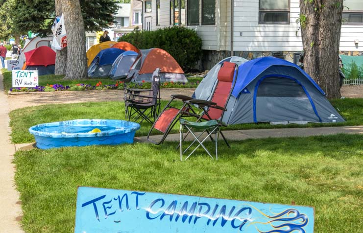 Tent camping in front yards at Sturgis Motorcycle Rally South Dakota