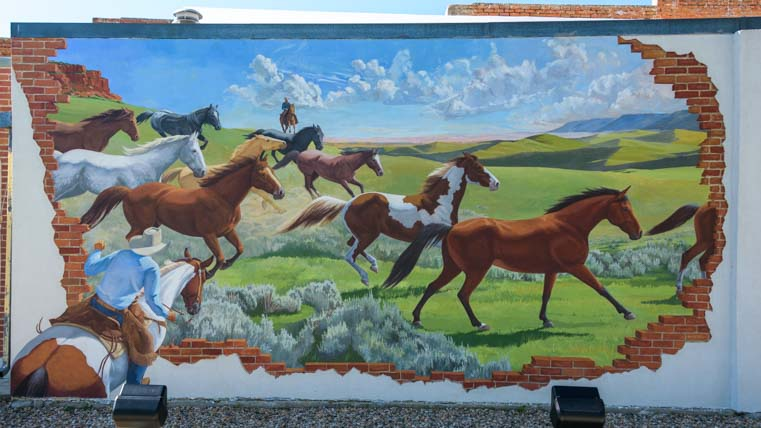 Horses on a mural Buffalo Wyoming by Aaron Wuerker and Jenny Wuerker
