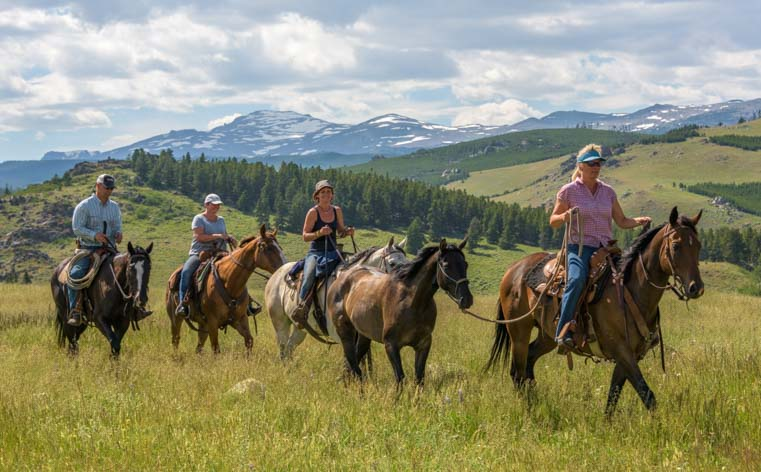 Horseback riders in Bighorn National Forest Bighorn Mountains