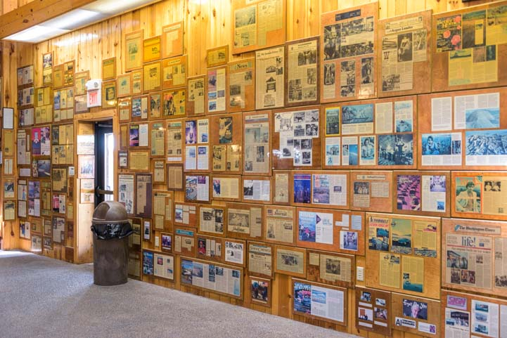 A wall full of newspaper and magazine articles about Wall Drug