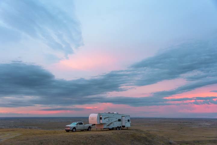RV sunset camping in South Dakota Badlands