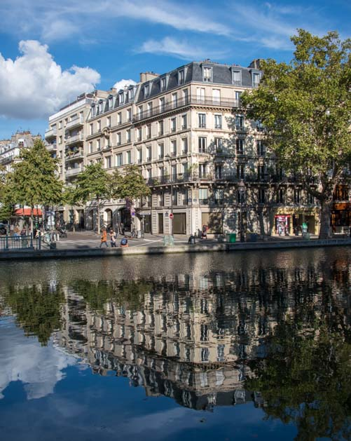 Reflections on canal in Paris
