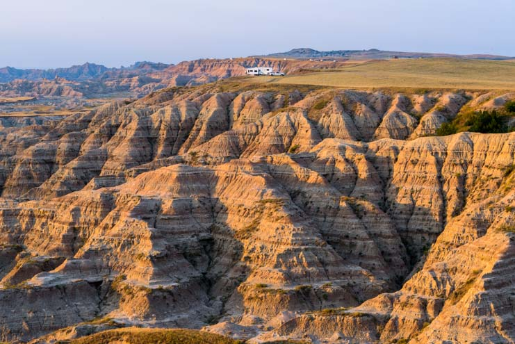 RV camping in the South Dakota Badlands at sunset
