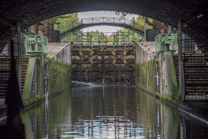 Entering canal lock on Canauxrama boat ride Paris