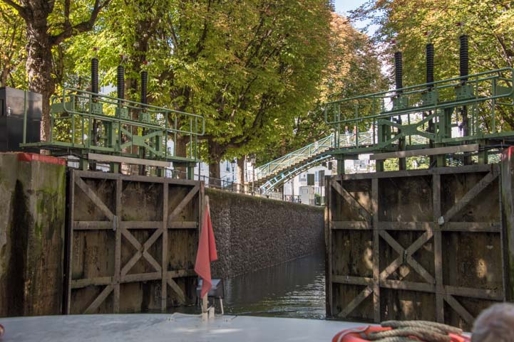 Canal lock doors open on Canauxrama boat ride Paris