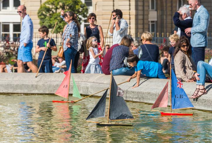 Kids play with Sailboats at Luxembourg Garden Paris