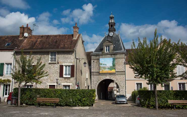 Medieval arch and buildings in Moret sur Loing France-min