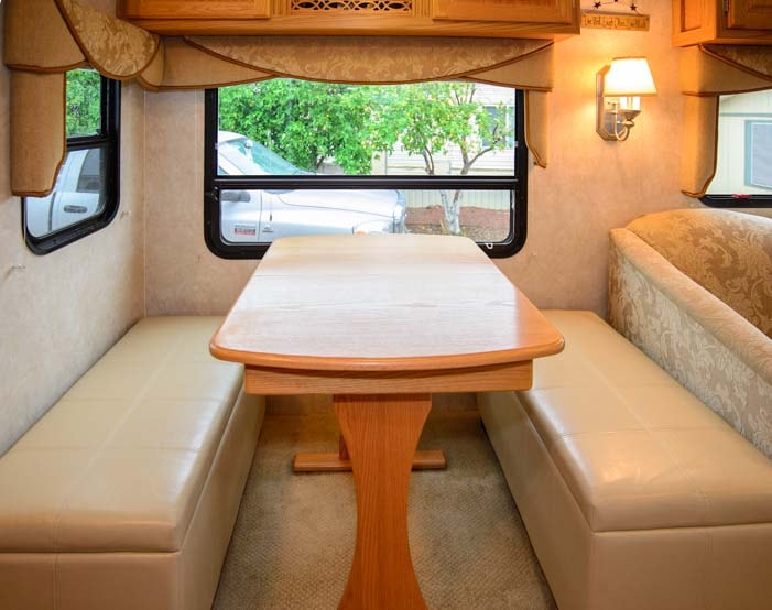 Storage benches in RV dinette add comfort and storage space-min